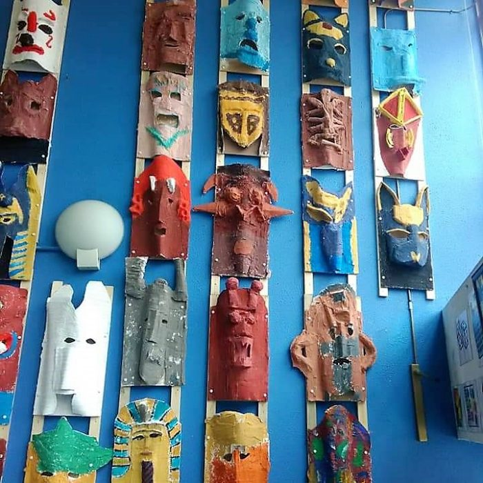 3D Tribal and Cultural Masks display in a school.