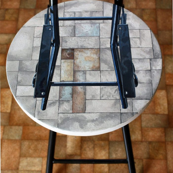 Painting of a stool from above with another stool on top. Painting by Irish Artist David O'Rourke