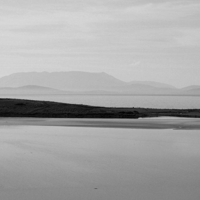 Photo of Achill Island, Mayo, Ireland showing a peninsula and grey sky by Irish Artist David O'Rourke