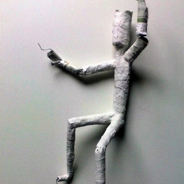 A figure made of wire, coated paper for an art project