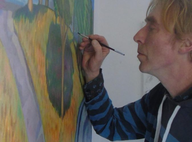 rish Artist David O'Rourke in action painting an image of Australia